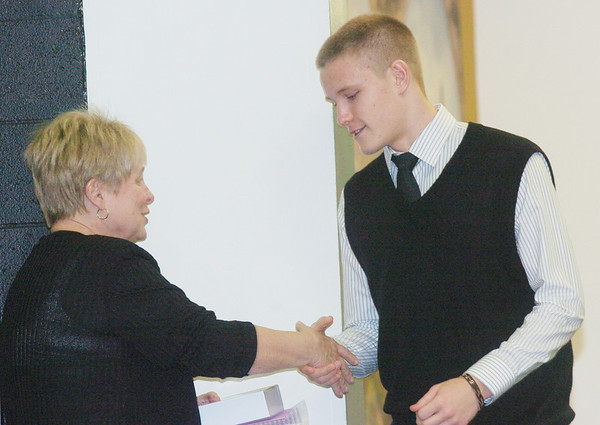 WARREN DILLAWAY / Star Beacon<br /> SUSAN HERPY presents Tony Chiacchiero of Jefferson with theRobert M. Herpy Memorial Scholarship Award Monday evening at the Ashtabula County Touchdown Club Banquet at Mount Carmel Community Center in Ashtabula.