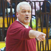 WARREN DILLAWAY / Star Beacon<br /> JOHN BOWLER, Edgewood basketball coach, instructs his team on Friday during a home game against Note Dame Cathedral Latin.