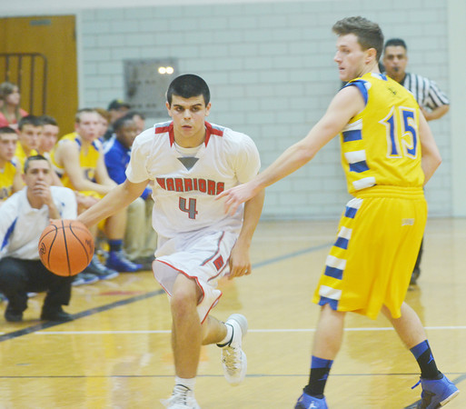 WARREN DILLAWAY / Star Beacon<br /> CONNOR MCLAUGHLIN (4) of Edgewood drives to the basket with Trevor Demaske (15) of Notre Dame Cathedral Latin defending on Friday night at Edgewood.