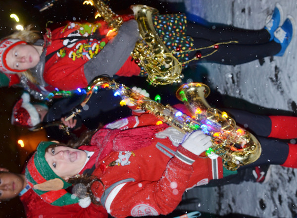 WARREN DILLAWAY / Star Beacon<br /> BROOKE JEWELL of the Geneva High School ban (left) prepares to march in the Geneva Christmas Parade on Friday evening.