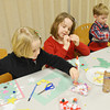 WARREN DILLAWAY / Star Beacon<br /> CHRISTMAS CRAFTS were a big part of the Conneaut Public Library Christmas party on Thursday evening. (From left) Natalee, 5, Rylee, 7, and Connor, 3, work on their projects during the party that drew hundreds of people to the library.