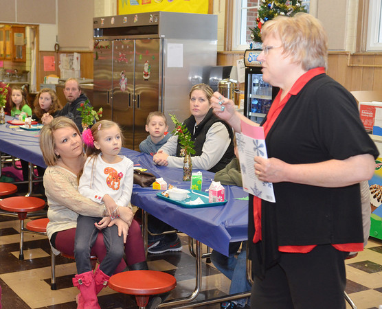 WARREN DILLAWAY / Star Beacon<br /> CAROL FALCIONE, reading coach at Kingsville and Ridgeview elementary schools, encourages parents to talk and read with their children regularly during a books for breakfast program at Kingsville Elementary School on Friday morning.