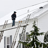 WARREN DILLAWAY / Star Beacon<br /> WILLIAM LAGO of Ralson Roofing and Construction clears snow from Plymouth United Methodist Church on Friday morning.