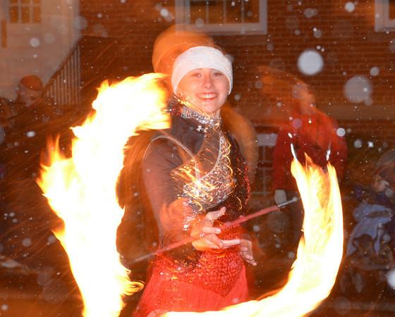 WARREN DILLAWAY / Star Beacon<br /> KOURTNEY CLARK of Victoria's Sparkling Twirlers prepares for the Geneva Christmas Parade on Friday evening in Geneva.