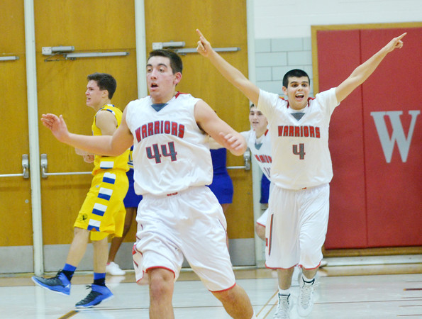 WARREN DILLAWAY / Star Beacon<br /> MATT FITCHET (44) and Edgewood teammate Connor McLaughlin (4) celebrate after knocking off Notre Dame Cathredral Latin on Friday night at Edgewood.