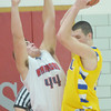 WARREN DILLAWAY / Star Beacon<br /> MATT FITCHET (44) of Edgewood defends Mark Koselac of Notre Dame Cathedral Latin on Friday night at Edgewood.