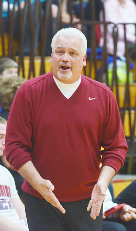 WARREN DILLAWAY / Star Beacon<br /> JOHN BOWLER, Edgewood basketball coach, questions a call on Friday during a home game against Note Dame Cathedral Latin.