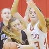 WARREN DILLAWAY / Star Beacon<br /> KELSEY FIORELL0 of Willoughby South (10) looks to pass  as Sarah Juncker of Geneva defends on Saturday afternoon in Geneva.