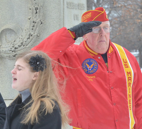 WARREN DILLAWAY / Star Beacon<br /> KAYLA PHAROS, a junior at Edgewood, sings the National Anthem during a Pearl Harbor Memorial Service at the Ashtabula Veterans Memorial on Saturday afternoon.