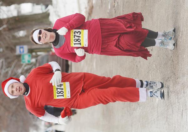 WARREN DILLAWAY / Star Beacon<br /> SHAWN AND Holly VanBuren of Ashtabula complete the Jingle Bell Three Mile Run on Saturday in Ashtabula.
