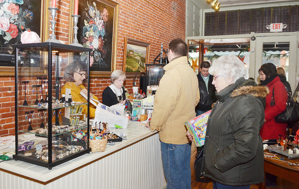WARREN DILLAWAY / Star Beacon<br /> SHOPPERS WAIT to check out on Saturday afternoon at DeFina's on Bridge Street during Harbor Merchants Open House in Ashtabula.