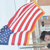 WARREN DILLAWAY / Star Beacon<br /> CARL DIDONATO presents the colors during a Pearl Harbor Day Memorial Service at the Ashtabula Veterans Memorial on Main Avenue on Saturday afternoon.