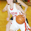 WARREN DILLAWAY / Star Beaco<br /> LINDSEY MAYLE of Geneva drives to the basket on Saturday afternoon during a home game with Willoughby South.