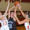 WARREN DILLAWAY / Star Beacon<br /> KAYLA ZARBOCK (22) of Willoughby South battles for the ball with Rachael Harrington (10) and Geneva Teammate Sarah Juncker (right) on Saturday at Geneva..