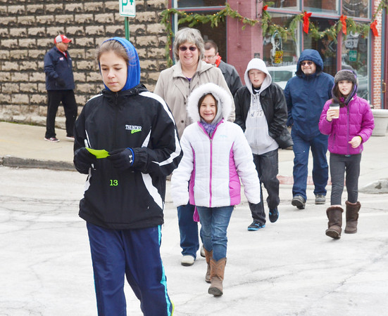 WARREN DILLAWAY / Star Beacon<br /> ANGELICA SACK, 14, of Jefferson, leads a group of people paricipating in a scavenger hunt during the Harbor Merchants Open House Saturday in Ashtabula.