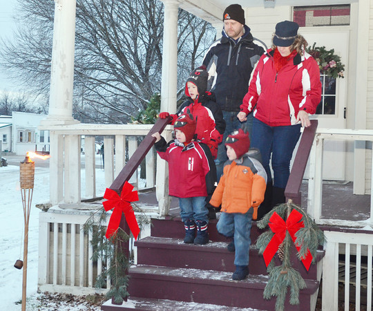 WARREN DILLAWAY / Star Beacon<br /> THE SPERO family of Conneaut Kasen and Keanan, 4, (front left to right) and Hamilton, 6, joined parents Heidi and Matt during a tour of the century home at the Jefferson Depot Village during the Old Fashioned Williamsburg Christmas Celebration on Saturday in Jefferson.