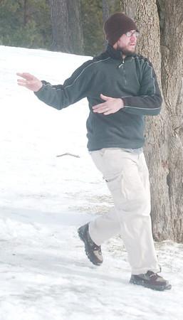 WARREN DILLAWAY / Star Beacon<br /> JOHN VERZELLA of Jefferson follows through on his disc golf shot on Saturday at Lake Shore Park during the 2013 Ice Bowl.
