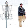 WARREN DILLAWAY / Star Beacon<br /> MARK VERZELLA sends his disc toward the cup at the 2013 Ice Bowl at Lake Shore Park in Ashtabula Township on Saturday.