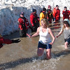WARREN DILLAWAY / Star Beacon<br /> PARTICIPANTS IN  in the Polar Bear Plunge at Geneva State Park's Breakwater Beach on Saturday prepare to slap hands with a safety volunteer.