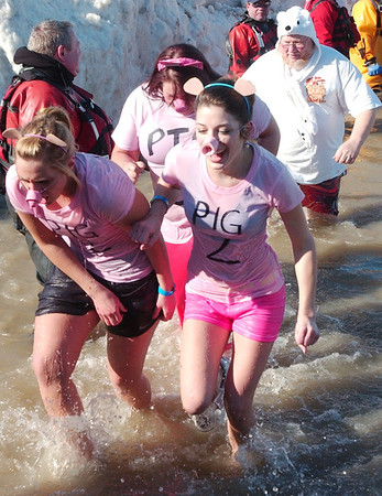 WARREN DILLAWAY / Star Beacon<br /> PIG SNOUTS were just one of the accesories for participants in the Polar Bear Plunge at Geneva State Park's Breakwater Beach on Saturday.