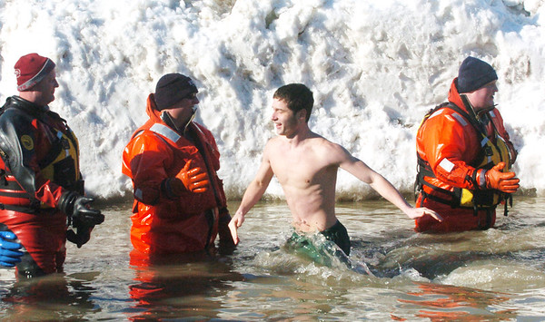 WARREN DILLAWAY / Star Beacon<br /> BRANDON LOPEZ, of Lakeside, dashes through the cold water on Saturday during the Polar Bear Plunge at Geneva State Park's Breakwater Beach.