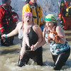 WARREN DILLAWAY / Star Beacon<br /> JENNIFER JOHNSTON (left) of Wickliffe and Andrea Brannen of Cleveland react to the cold water on Saturday during the Polar Bear Plunge at Geneva State Park's Breakwater Beach.