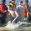 WARREN DILLAWAY / Star Beacon<br /> CHRISTIAN BURNS (left) and Robbie Brecker lead a group of Lakeside High School students on Saturday during the Polar Bear Plunge at Geneva State Park's Breakwater Beach.