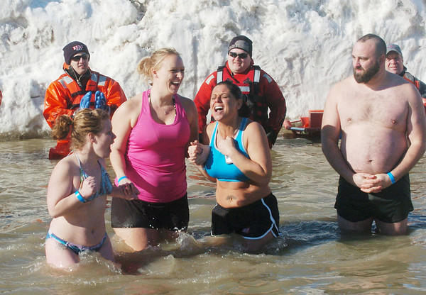 WARREN DILLAWAY / Star Beacon<br /> JESSICA POLCIATA (second from right) reacts to the cold water during the Super Plunge portion of the Polar Bear Plunge on Saturday at Geneva State Park's Breakwater Beach.
