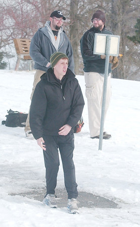 WARREN DILLAWAY / Star Beacon<br /> TRAVIS ISENBERG (foreground) watches his disc fly during the 2013 Ice Bowl at Lake Shore Park on Saturday in Ashtabula Township.