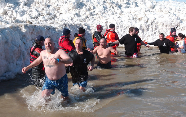 WARREN DILLAWAY / Star Beacon<br /> PARTICIPANTS IN the Polar Bear Plunge at Geneva State Park's Breakwater Beach dash out of the water on Saturday.