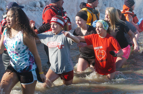 WARREN DILLAWAY / Star Beacon<br /> GENEVA HIGH Shcool students react to the cold water on Saturday during the Polar Bear Plunge at Geneva State Park's Breakwater Beach.