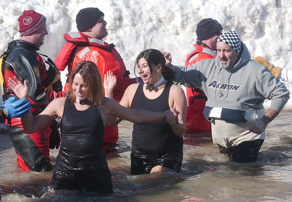 WARREN DILLAWAY / Star Beacon<br /> SMILES SEEMED mandator for participans in the Polar Bear Plunge at Geneva State Park's Breakwater Beach on Saturday.