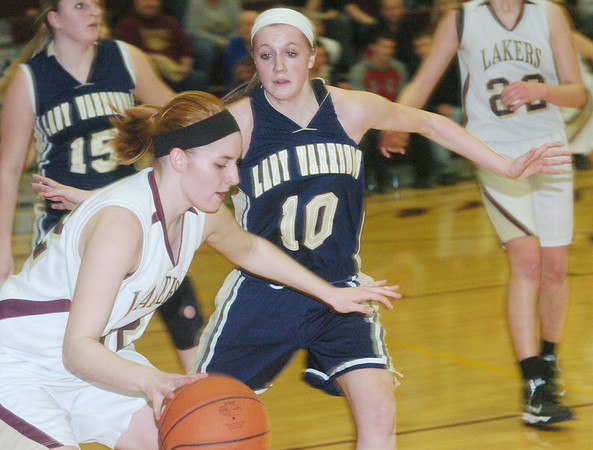 WARREN DILLAWAY / Sta r Beacon<br /> HEATHER BRANT of Pymatuning Valley dribbles by Kayla Boyer of Brookfield (10) on Monday in Andover Township.