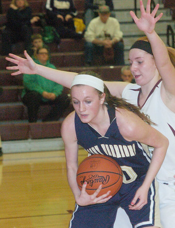 WARREN DILLAWAY / Sta r Beacon<br /> HEATHER BRANT of Pymatuning Valley defends Kayla Boyer of Brookfield (with ball) on Monday in Andover Township.