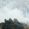 WARREN DILLAWAY / Star Beacon<br /> SMOKE RISES above a pile of rubble on Tuesday morning after the former General Alumninum building burned Monday night in Conneaut.