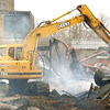 WARREN DILLAWAY / Star Beacon<br /> HEAVY EQUIPMENT is used to sift through the remnants of the former General Alumninum building Tuesday morning afterit burned Monday night in Conneaut.