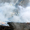 WARREN DILLAWAY / Star Beacon<br /> HEAVY EQUIPMENT is used to sift through the remnants of the former General Alumninum Tuesday morning after it burned Monday night in Conneaut.