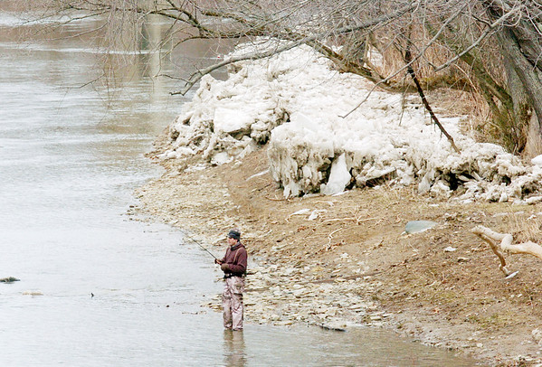WARREN DILLAWAY / Star Beacon<br /> MODERATING TEMPERATURES allowed fishermen to work Conneaut Creek, near the Old Main Road bridge in Conneaut, and other area tributaries but an icy reminder that winter is still with us lurked ominously behind on Friday afternoon.