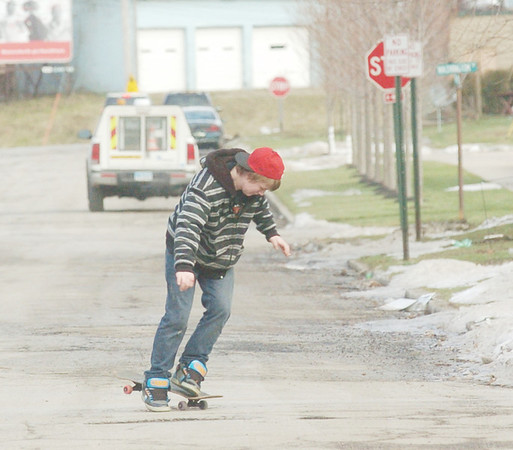 WARREN DILLAWAY / Star Beacon<br /> JAMES HILL, 14, of Ashtabula, works on his skateboarding moves along West 57th Street in Ashtabula on Friday afternoon.