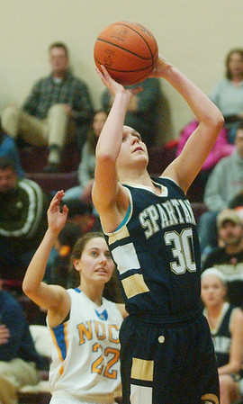 WARREN DILLAWAY / Star Beacon<br /> LEXI ZAPPITELLI (30) of Conneaut prepares to shoot in front Katie Trushel of Notre Dame Cathedral Latin on Saturday evening at Pymatuning Valley during Division II sectional action.