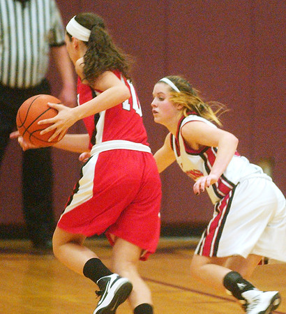 WARREN DILLAWAY / Star Beacon<br /> JESSICA BECKER (right) of Jefferson defends Celeste Farrell of Perry on Saturday night during Division II sectional action at Pymatuning Valley.