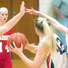 WARREN DILLAWAY / Star Beacon<br /> BRIANNE GOODRICH (42) of West Geauga is surrounded by Edgewood defenders Courtney Humphrey (42), Carrie Pascarella (14) and Alyssa Johnson (25), all of Edgewood during Division II sectional action at Pymatuning Valley on Monday night.