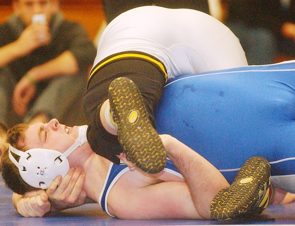 WARREN DILLAWAY / Star Beacon<br /> JOE BASHORE of Madison tries to keep his shoulders off the mat as EvaN Rosborough of Riverside goes for the pin during a 220 pound bout on Saturday during the PAC wrestling meet at Madison.
