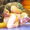 WARREN DILLAWAY / Star Beacon<br /> OTIS CONEL of Lakeside wrestles Nick Denman of Riverside during a182 pound bout on Saturday during the PAC wrestling meet at Madison.
