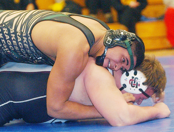 WARREN DILLAWAY / Star Beacon<br /> CHUCK MORGAN (top) of Lakeside wrestles Kostas Parrish of University School on Saturday during a 285 pound bout at the PAC wrestling meet at Madison.
