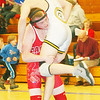 WARREN DILLAWAY / Star Beacon<br /> TYLER CROSS of Geneva picks up Alex Ivary of Riverside on Saturday during a 145 pound match at the PAC wrestling meet at Madison.