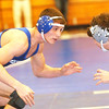 WARREN DILLAWAY / Star Beacon<br /> RYAN MONTGOMERY (left) of Madison wrestles Matt Moyseenko of Willoughby South on Saturday during the PAC wrestling meet at Madison.