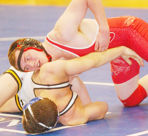 WARREN DILLAWAY / Star Beacon<br /> TYLER CROSS of Geneva picks controls Alex Ivary of Riverside on Saturday during a 145 pound match at the PAC wrestling meet at Madison.