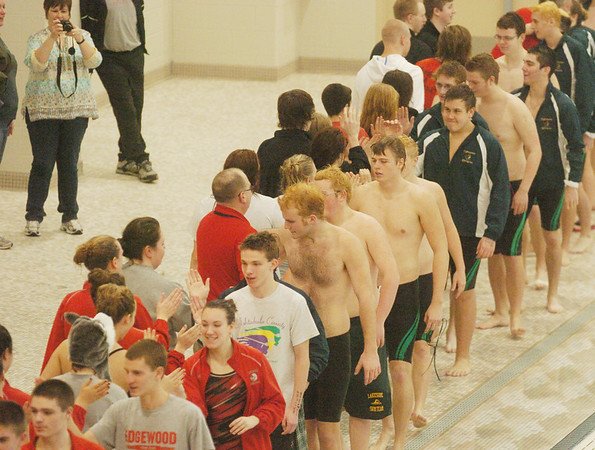 WARREN DILLAWAY / Star Beacon<br /> SWIMMERS SHAKE hands after the Ashtabula County Invitational on Saturday at Spire Institute in Harpersfield Township.