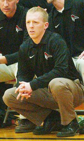 WARREN DILLAWAY / Star Beacon<br /> AL IACOFANO, Perry boys basketball coach, watches the action Friday night at Edgewood.
